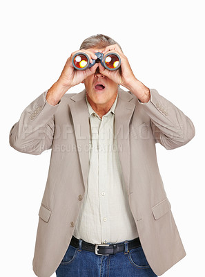 Buy stock photo Studio shot of a mature man looking through binoculars against a white background