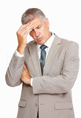 Buy stock photo Studio shot of a mature businessman experiencing a headache against a white background