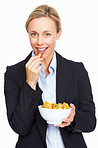 Business woman eating fruit salad