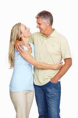 Buy stock photo Two young happy couple looking at each other on white background