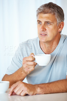Buy stock photo Portrait of mature man with cup of tea and thinking indoors