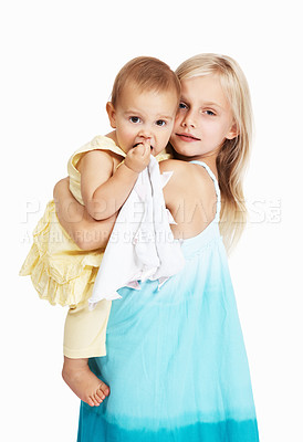 Buy stock photo A young girl carrying her baby sister while isolated on a white background