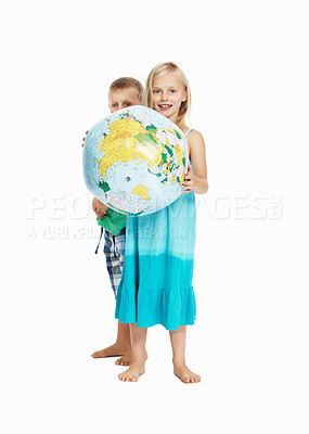 Buy stock photo Portrait of young girl holding globe with boy in the back