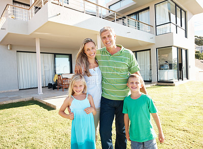 Buy stock photo Attractive happy family standing together outside their home