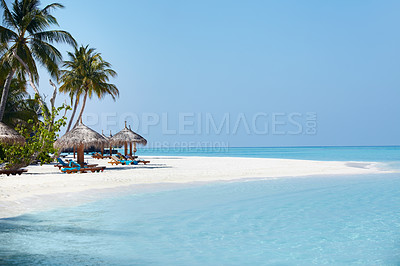Buy stock photo Panoramic view of a beautiful beach with chair and umbrella