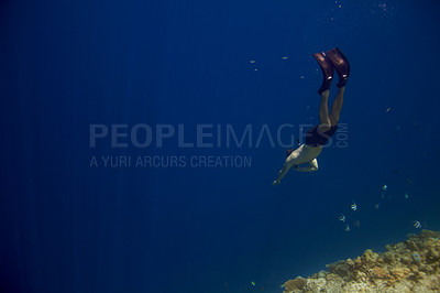 Buy stock photo Portrait of smart young man swimming deep to the sea - Scuba