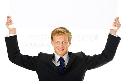 Buy stock photo Studio shot of a young businessman holding up a blank card isolated on white