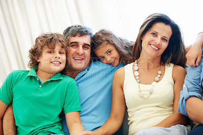 Buy stock photo Happy parents with son and daughter sitting together