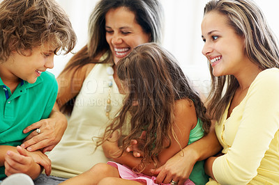 Buy stock photo Portrait of a cheerful mature mother playing with her kids at home