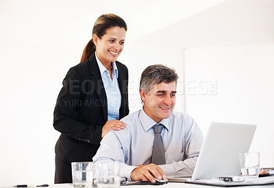 Buy stock photo Mature business executives using laptop together in the office
