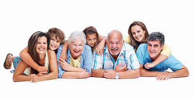 Buy stock photo Three generation family lying together on studio floor with copyspace