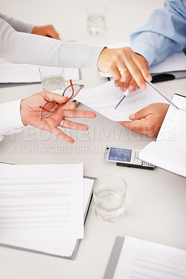 Buy stock photo Closeup of hands with financial charts at business meeting in the office
