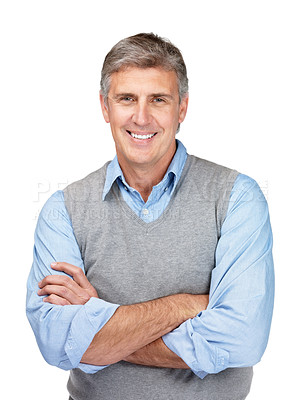 Buy stock photo Portrait of a happy middle aged man standing with folded hands against white background