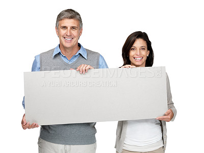 Buy stock photo Portrait of a happy mature couple  holding a blank billboard on white background