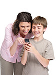 Happy mother and her son using a mobile phone