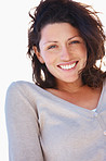 Portrait of a pretty young lady smiling outdoors