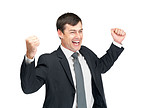 Celebration - Happy energetic businessman with his arms raised