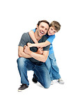 Happy father and son enjoying themselves on white background