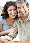 Cosy mature couple smiling together