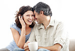 Portrait of beautiful mature couple sitting together