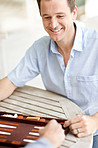 Happy young man enjoying a game of backgammon