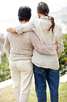 Rear view of a loving senior couple standing in a park