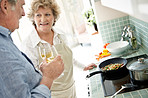 Modern lifestyle - Mature couple with wine glasses in their kitc