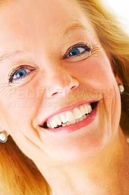 Buy stock photo Closeup studio portrait of an attractive mature woman smiling at the camera