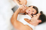 Young couple enjoying themselves on bed
