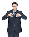 Disappointed business man gesturing a thumbs down sign on white