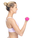 Side view of a woman working out with dumbbells
