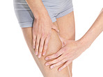 Mid section of a woman holding thigh for skin fold test