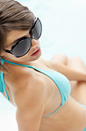 Lovely young woman in bikini and sunglasses