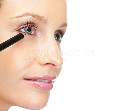 Buy stock photo Closeup cropped image of a happy female applying eye liner to eyes against white background