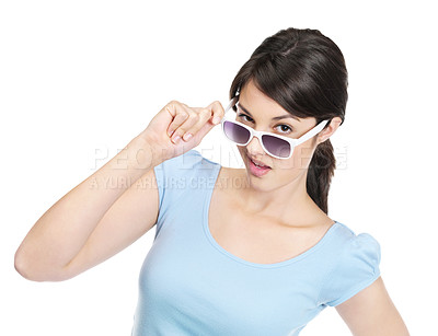 Buy stock photo Portrait of a cute young female wearing sunglasses isolated against white