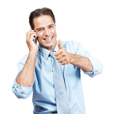 Buy stock photo Studio shot of a businessman showing thumbs up while talking on his cellphone against a white background