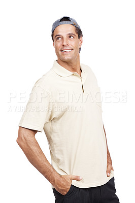 Buy stock photo Studio shot of a man standing with his hands in pockets against a white background