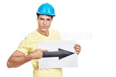 Buy stock photo Shot of a construction worker holding a sign with an arrow pointing to the right on it