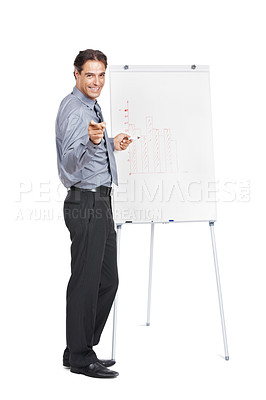 Buy stock photo Studio portrait of a businessman standing by a whiteboard with a graph on it