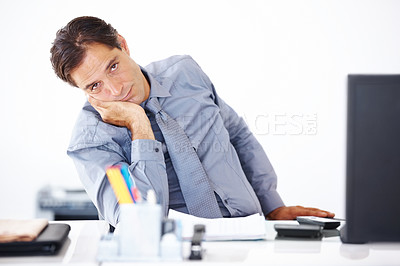 Buy stock photo Portrait of a bored business man sitting at his office desk