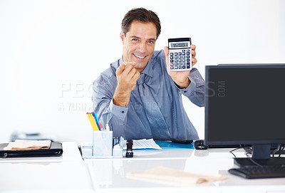 Buy stock photo Portrait of a confident business manager at his desk showing a calculator to you