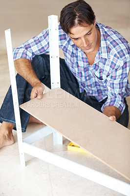 Buy stock photo Mature carpenter working in his workshop laying a wooden plank