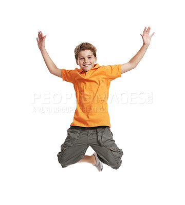 Buy stock photo Portrait of happy little boy jumping in mid air isolated on white background