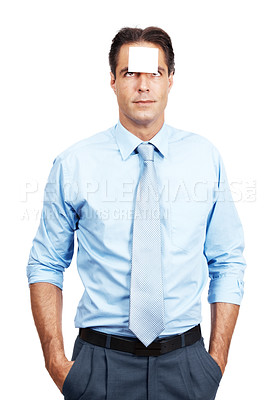Buy stock photo Shot of a mature businessman with a blank sticky note on his forehead