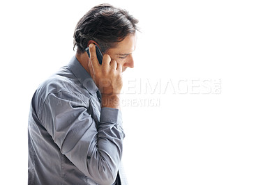 Buy stock photo Shot of a businessman talking on his cellphone against a white background