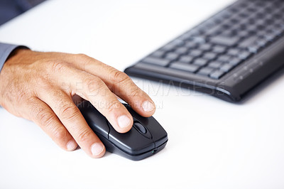 Buy stock photo Closeup of business man's hand using computer mouse computer and keyboard in side