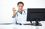 Medical doctor sitting relaxed at his office desk