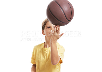 Buy stock photo Sweet little child balancing basketball on fingers against white background