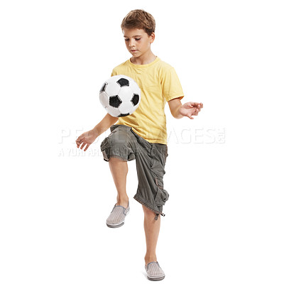 Buy stock photo Portrait of a sweet little boy playing football isolated against white background