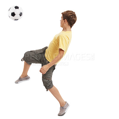 Buy stock photo Portrait of a young boy kicking the soccer ball against white background